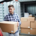 Man storing household goods at Total Self Storage
