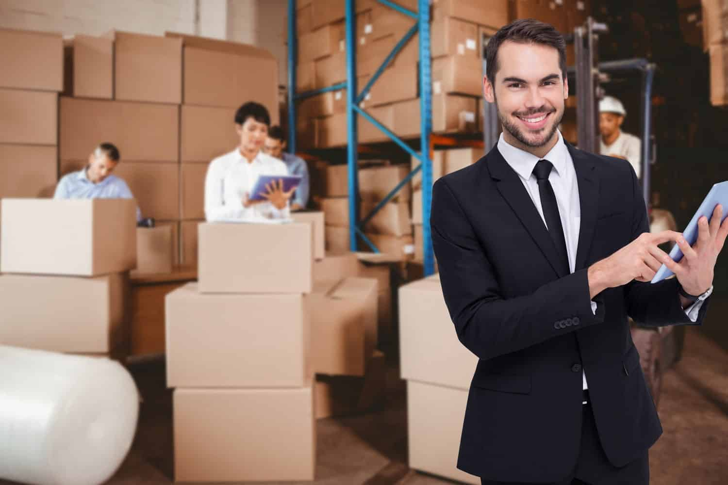 Employees checking business goods stored at Total Self Storage